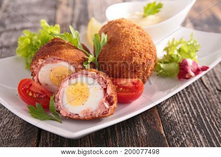 boiled egg and meat with salad