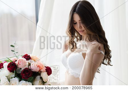 beautiful sensual woman in fashionable white bra