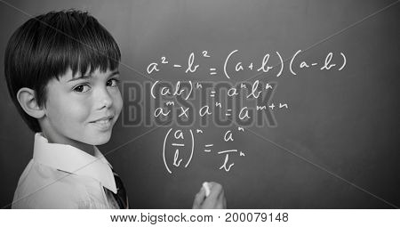 Digital composite of Boy writing math equations on blackboard