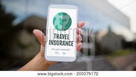 Digital composite of Person holding a phone with travel insurance concept on screen