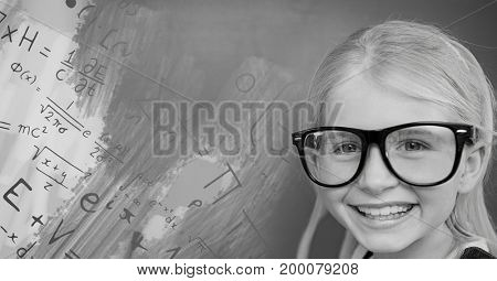 Digital composite of Girl with glasses next to equations theory on blackboard