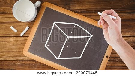 Digital composite of Hand drawing cube on blackboard