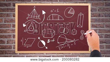 Digital composite of Hand drawing diagrams on blackboard