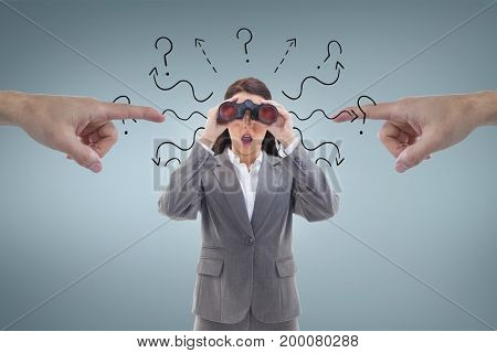 Digital composite of Hands pointing at excited business woman looking through binoculars against blue background