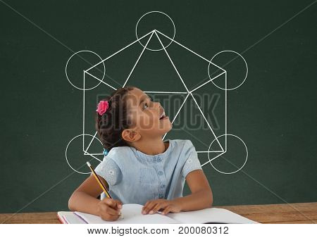 Digital composite of Student girl at table looking up against green blackboard with school and education graphic