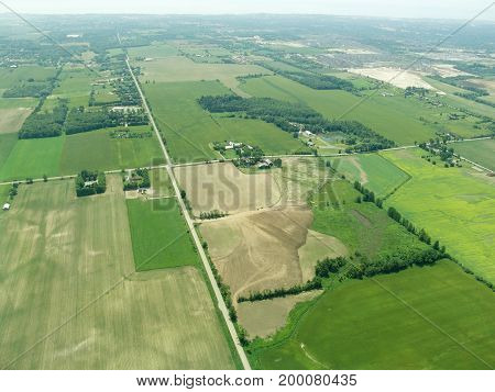 Aerial view of countryside in summer - green fields and farms Ontario Canada