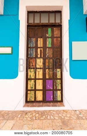 View of the bright old door Santo Domingo Dominican Republic. Copy space for text. Vertical