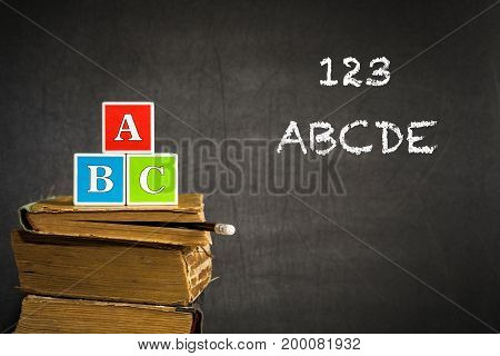 Abc On Books Against Blackboard