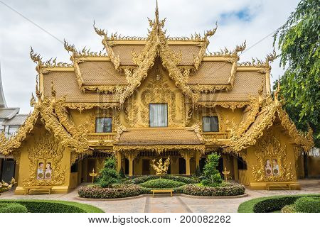 Wat Rong Khun The Abstract Golden Temple And Pond With Fish, In Chiang Rai, Thailand. Popular And Fa