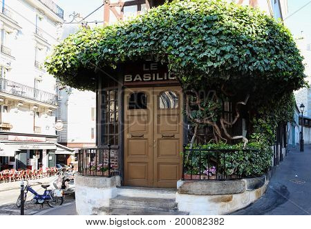 Paris, France-August 06, 2017: The traditional French restaurant Le Basilic located in picturesque Montmartre district of Paris.