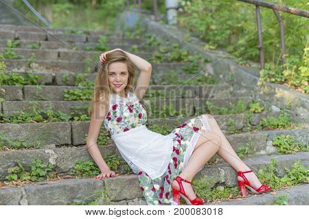 Beautiful Girl Sitting On Stone Steps