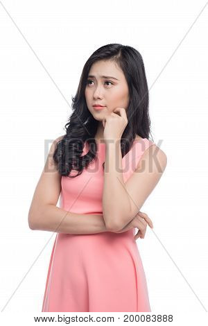 Asian young beautiful woman thinking and standing over white.