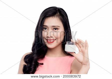 Pretty asian young woman holding moisturize jar