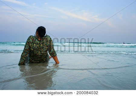 Women lady sitting on beach in the sea