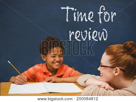 Digital composite of Student boy and teacher at table against blue blackboard with time for review text