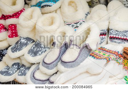 Handmade warm knitted footwear and socks in the market