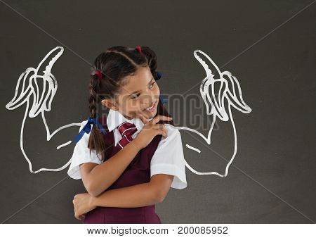 Digital composite of Student girl with fists graphic standing against grey blackboard