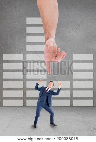 Digital composite of Hand pointing at scared business man against grey background with infographics