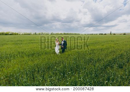 Wedding Couple On A Walk In Nature