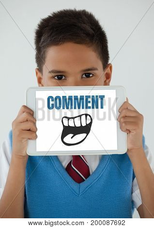 Digital composite of Comment text and cartoon mouth graphic on tablet screen with boy