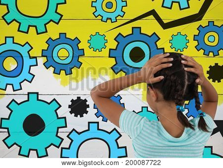Digital composite of Girl looking at settings gear cogs