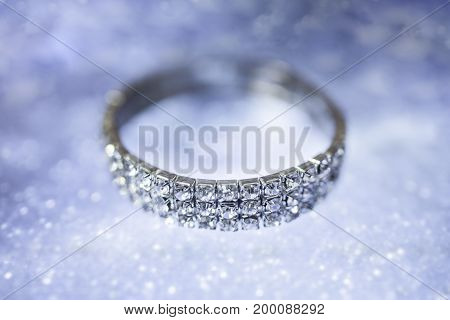 Diamond bracelet on a mirror blurred blue background
