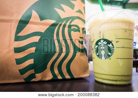 Nakhon Ratchasima, Thailand - June 26, 2017: Starbucks Take Away, Iced Latte Coffee Cup With Paper B