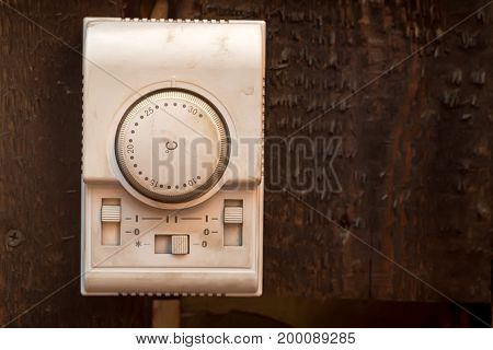 Close up white climate control panel on wooden wall