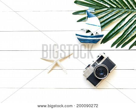 Summer  accessories, camera and sunglasses go to travel in the beach. Tropical sea.Unusual top view,    Summer Concept.