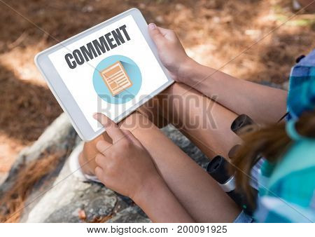 Digital composite of Comment text and graphic on tablet screen with womans hands
