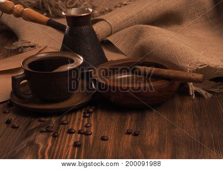Coffee Cup On A Wooden Backgound.