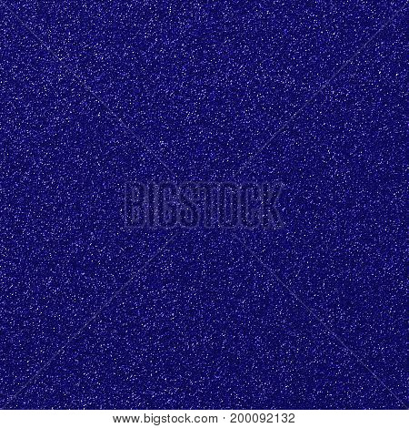 A digitally created blue glitter paper background texture.