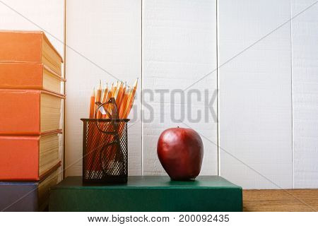 Books Pencil And Glasses On A White Wooden Table And Decorations