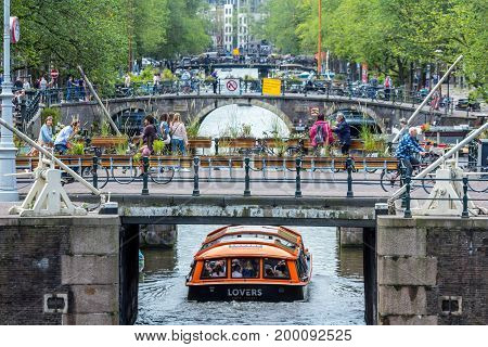 Amsterdam the Netherlands - 13 August 2017: people crossing bridges on the Prinsengracht