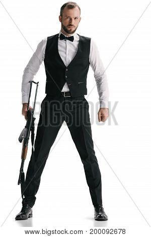 handsome young secret agent in suit with rifle isolated on white