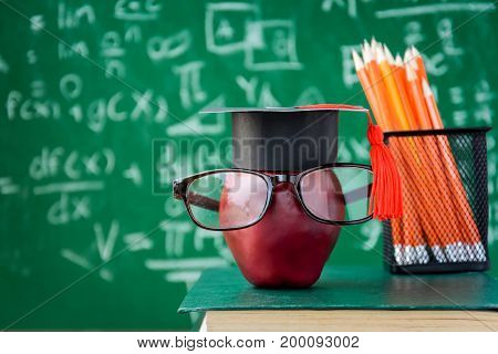 Apple Knowledge Symbol And Pencil Books On The Desk