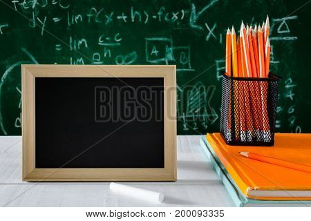 Book And Pencil On White Table Black Board Background With Study