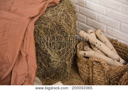 Hay And Birch Firewood In A Room