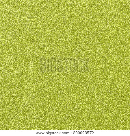 A digitally created gold glitter paper background texture.