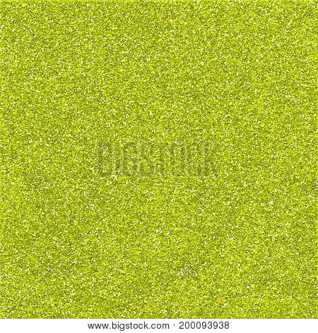 A digitally created lime green glitter paper background texture.