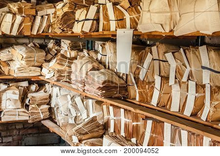 Closeup At Paper Waste Background. Keeping Records In Shelves