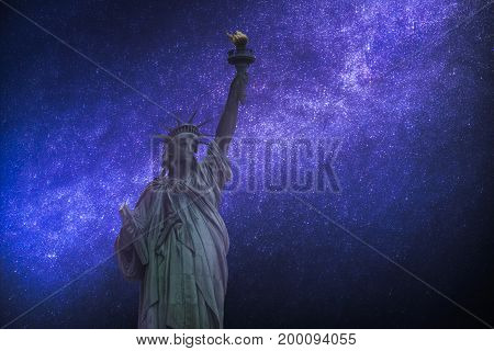 Astrophotography, Starry Sky Shines At Night. Statue Of Liberty
