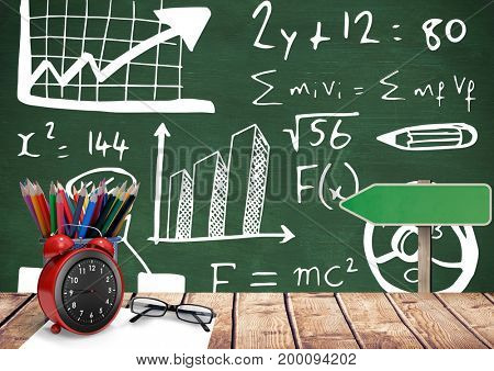 Digital composite of Desk foreground with blackboard graphics of formula equations