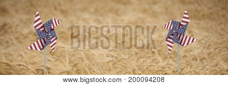 Digital composite of USA wind catchers in front of crop field