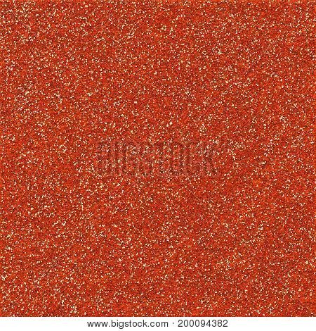 A digitally created orange glitter paper background texture.