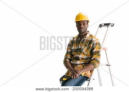 Thoughtful Builder Sitting On Ladder
