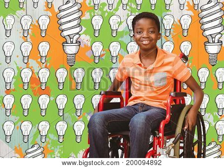 Digital composite of Disabled boy in wheelchair with light bulbs and paint drawings