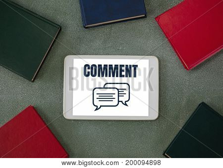 Digital composite of Comment text and chat graphic on tablet screen with books