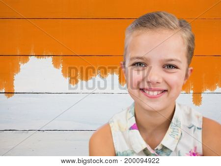 Digital composite of Girl smiling in front of painted orange wall