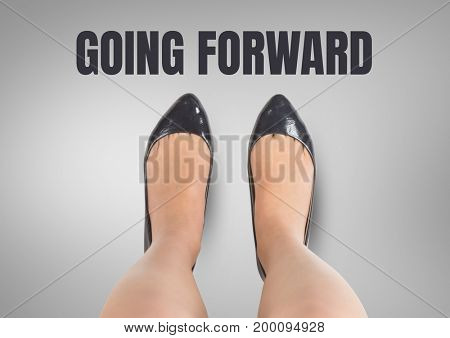 Digital composite of Going forward text and Black shoes on feet Blue shoes on feet with grey background